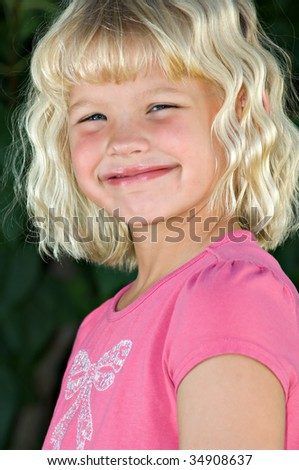 A beautiful, cherubic six year old blond girl