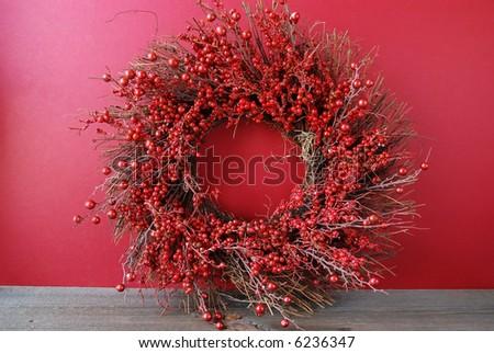 A beautiful christmas berry wreath - stock photo