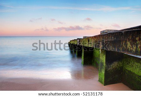 A beautiful coastal scene, the sand has been swept clean by the tide - stock photo