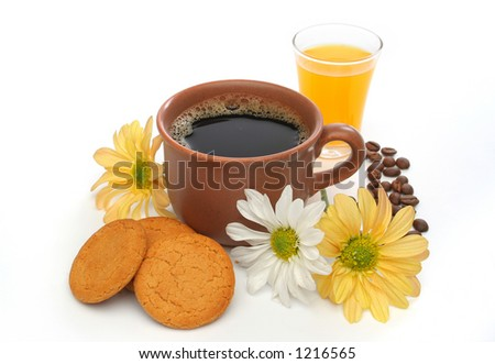 A beautiful coffee breakfast with cookies, orange juice, coffee beans and flowers.  Look at my gallery for more delicious meals