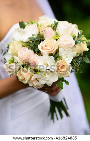 A beautiful colorful wedding bouquet for the bride. Details for marriage, and for spouses