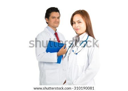 A beautiful confident Asian female, hispanic male doctors team smiling warmly showing compassion, caring, kindness and empathy. Focus on foreground H - stock photo