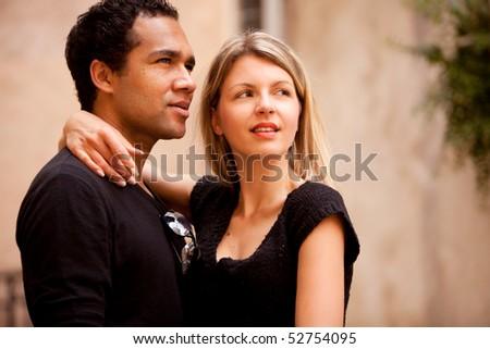 A beautiful couple in an outdoor urban setting - stock photo