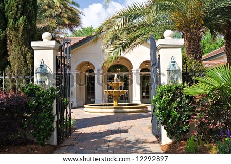 A beautiful courtyard with fountain in front of South Carolina home. - stock photo