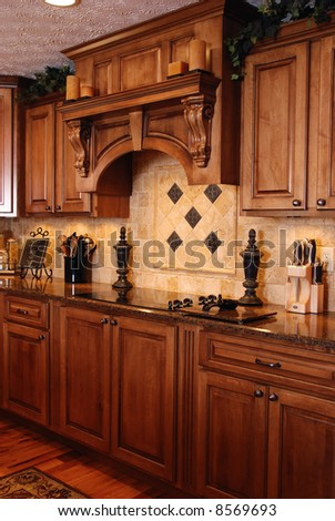 A beautiful custom kitchen - stock photo