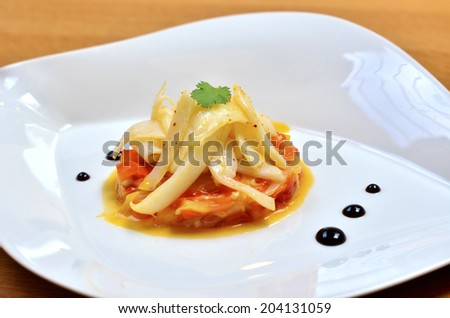 A beautiful delicious meal with calamari, pepper �  la basque - stock photo