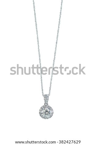 A beautiful diamond halo and white gold pendant dangles from a chain. Fine Jewelry necklace isolated on a white background with shadow and reflection - stock photo