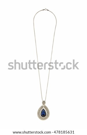 A beautiful diamond halo and white gold pendant dangles from a chain. Fine Jewelry necklace isolated on a white background with shadow and reflection