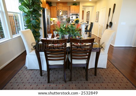 A beautiful dining room and kitchen interior inside an upscale home