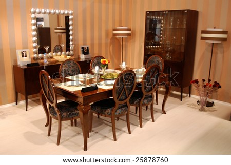 A beautiful dinning room with brown furniture - stock photo