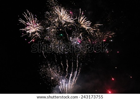 A Beautiful Display of a Large Firework Display. - stock photo