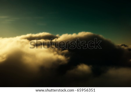 A beautiful, dreamy cloud scape from an airplane window. - stock photo