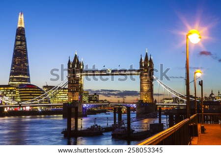 A beautiful dusk-time view of London Tower Bridge, City Hall, River Thames, the dome of St. Pauls Cathedral and the tip of Monument. - stock photo
