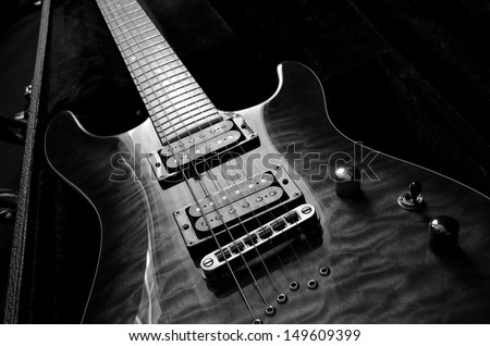 a beautiful electric guitar in a hard case - stock photo