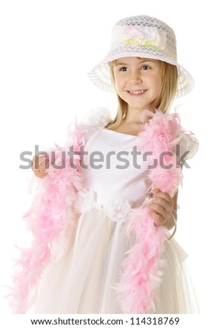 A beautiful elementary girl happily dressed up in white with a long, pink boa.  On a white background.