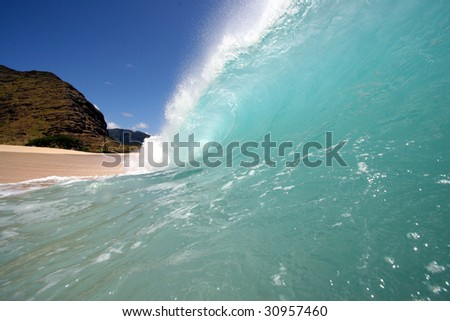 a beautiful empty wave breaks on the shore - stock photo