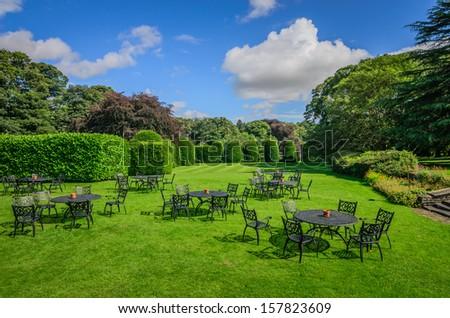 A beautiful English garden set up for a  tea party - stock photo
