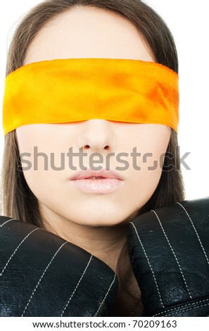 A beautiful face of woman, next to the boxing gloves with a orange blindfold on a white background, close-up - stock photo