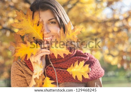 A beautiful female dreams in the autumn park.