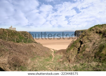 a beautiful fenced path to Ballybunion beach and castle - stock photo