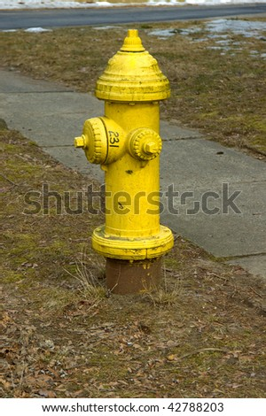 A beautiful fire extinguisher on a lawn - stock photo