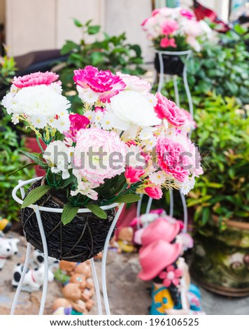 A beautiful flower decoration with artificial roses.