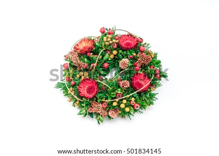 a beautiful flower wreath with colorful blooming flowers, on isolated white background