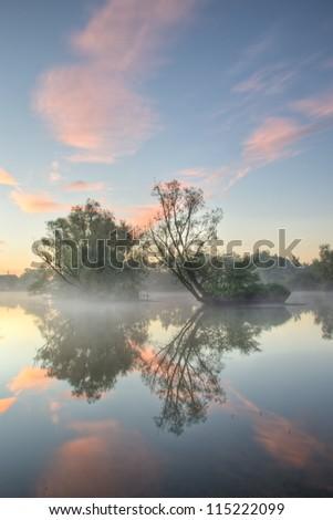 A beautiful foggy sunrise - stock photo