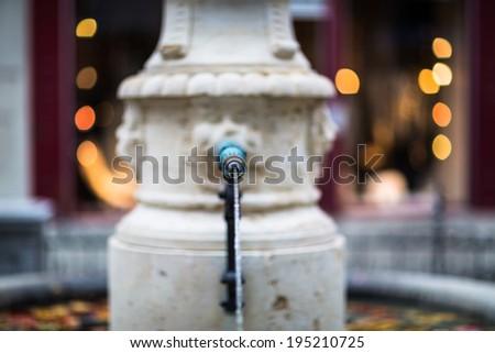 A beautiful fountain, Zurich, Switzerland (shallow DOF) - stock photo