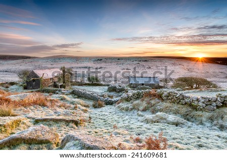 A beautiful frosty winter sunrise over an old abandoned farm at Garrow Tor on Bodmin Moor in Cornwall - stock photo