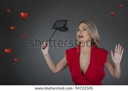 A beautiful girl catching hearts - stock photo
