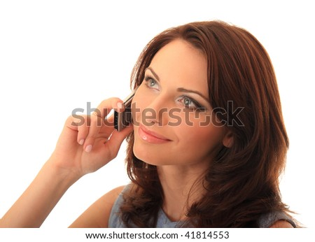 A beautiful girl communicates on a mobile telephone. - stock photo