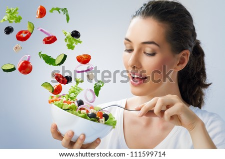 A beautiful girl eating healthy food
