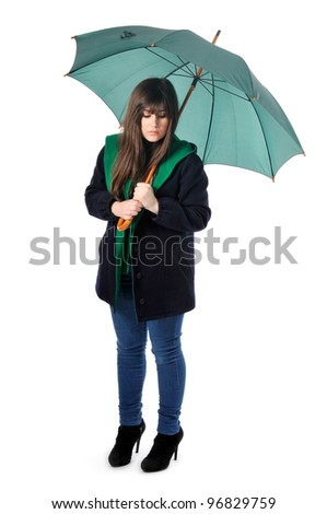 a beautiful girl holds an opened umbrella in white background - stock photo