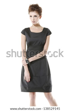 a beautiful girl in black dress posing on white background - stock photo