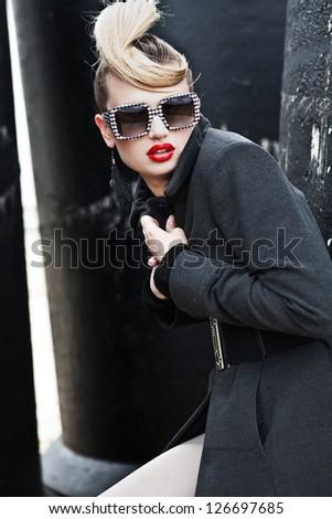 A beautiful girl in sunglasses - stock photo