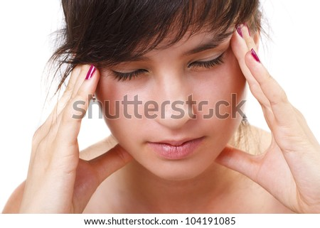 A beautiful girl is having a headache - isolated on white - stock photo