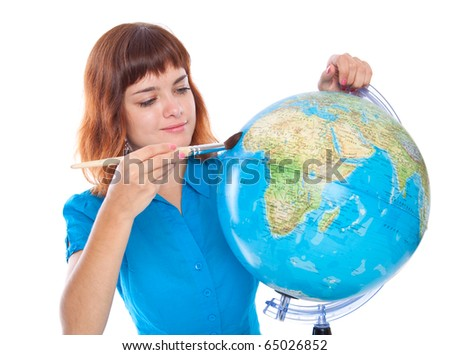 a beautiful girl is painting on the globe. isolated on white background