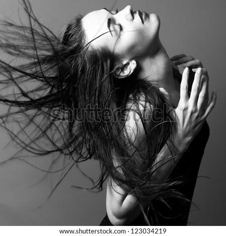 A beautiful girl  is posing in a studio - stock photo