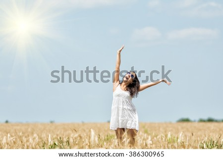 A beautiful girl on the nature rejoices sun. Her good mood.