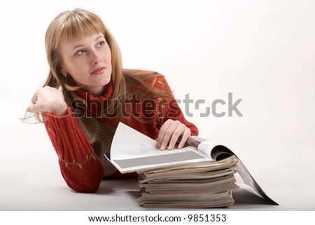 A beautiful girl reading magazines
