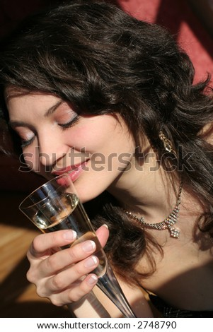 A beautiful girl relaxing with a glass of champagne.