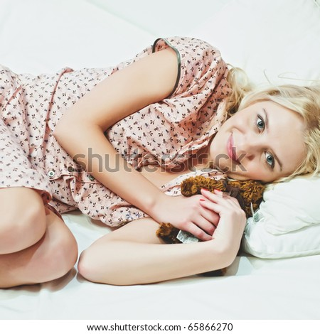 A beautiful girl resting on the bed - stock photo