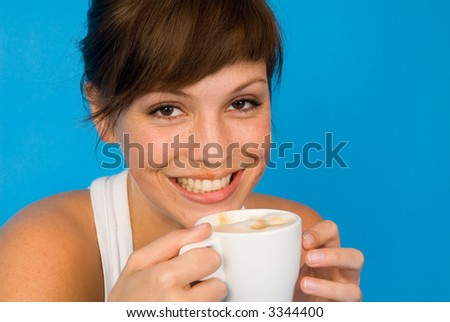 a beautiful girl with a cup of coffee - stock photo