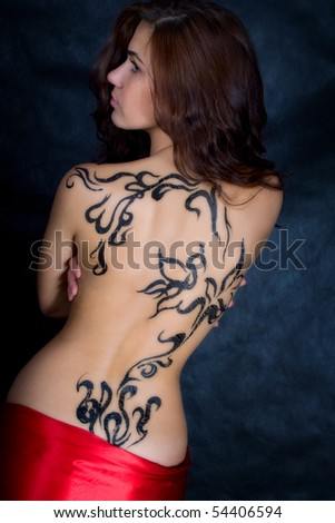 A beautiful girl with a pattern on its back in the Oriental style - stock photo