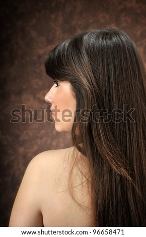 a beautiful girl with back turned - stock photo
