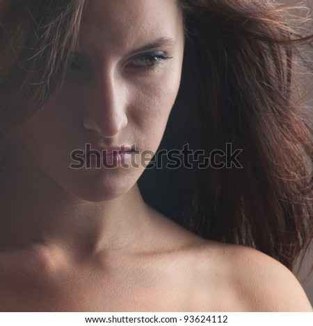 A beautiful girl with developing hairs looking sideways - stock photo
