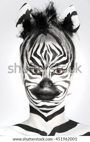 a beautiful girl with makeup zebra - stock photo