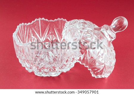 A beautiful glass bowl. They may be kept within the sweets, jewelry or some personal belongings. - stock photo