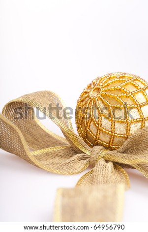 a beautiful golden lace made of golden ribbon and a golden ball